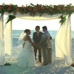 Jewish couple standing under chuppah at Lido Beach Resort wedding ceremony